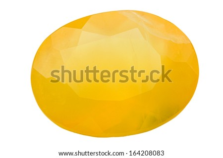 A rich yellow Fire Opal in oval form. - stock photo