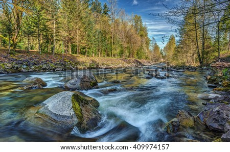 A River Runs through the Cascade Mountains just outside of Seattle, Wa on an Early Spring Day - stock photo