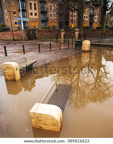 A riverside sitting area under water during a flood - stock photo