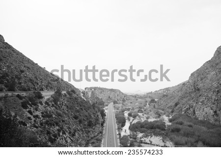 A road between the mountains - stock photo