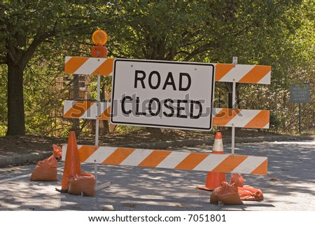 A road closed sign on a new bridge construction site - stock photo