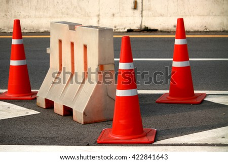A road cone on the road - stock photo