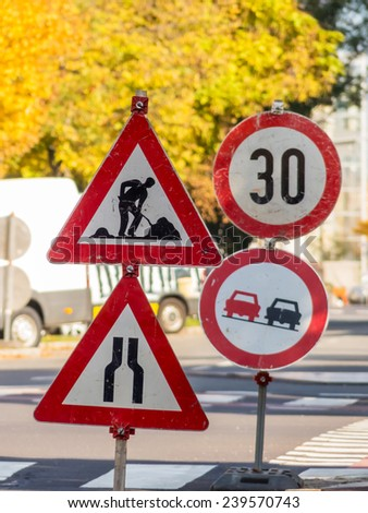 a road construction site is protected by several signs. - stock photo