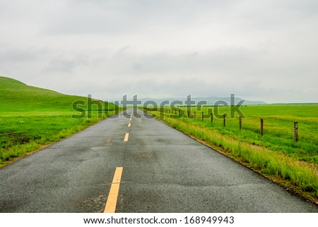 a road in prairie, Inner-Mongolia, China - stock photo