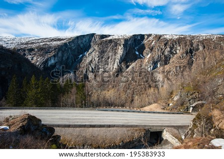 A road on the way up to the mountain passage between Bergen and Oslo in Norway - stock photo
