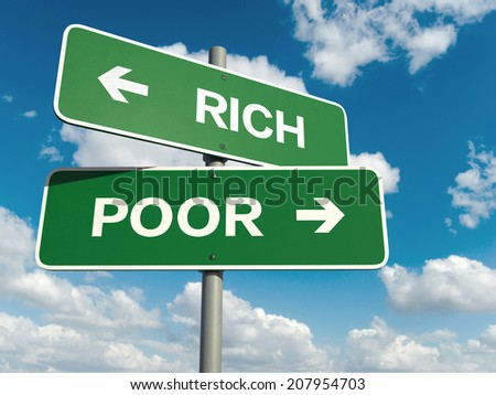 A road sign with rich poor words on sky background  - stock photo