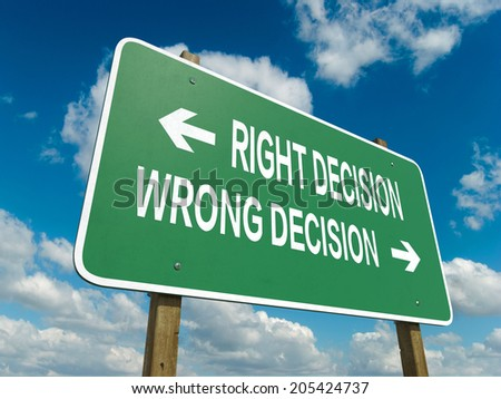 A road sign with right decision wrong decision words on sky background  - stock photo