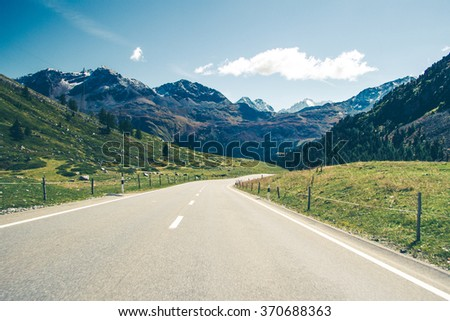 A road through swiss Alps. - stock photo