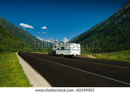a road to the mountains - stock photo