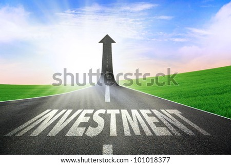 A road turning into an arrow rising upward symbolizing growth and improvement of investment - stock photo