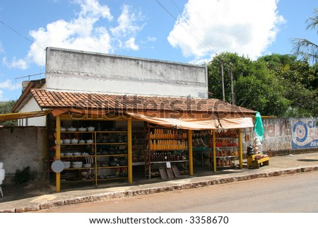 A roadside market in Brazil selling artisan food products and cookware. - stock photo