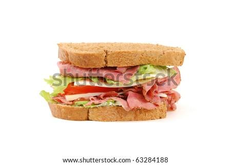 A roast beef sandwich on medium rye bread - stock photo
