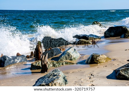 A rocky shoreline at Sandy Hook along the Jersey shore. - stock photo