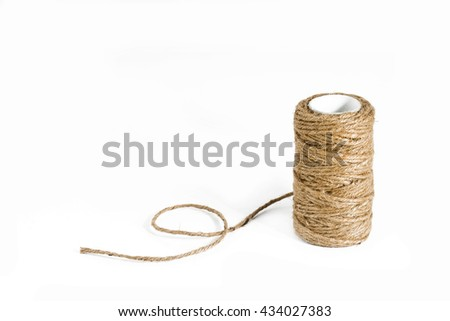 A Roll of hemp rope on white background - stock photo
