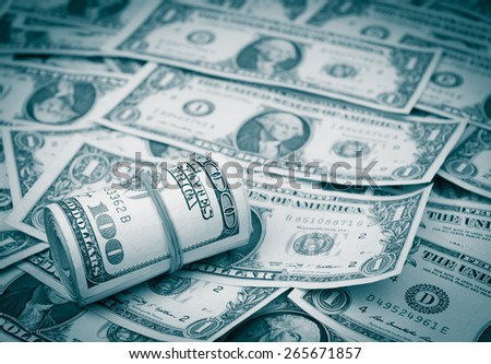 A roll of hundred dollar banknotes - stock photo