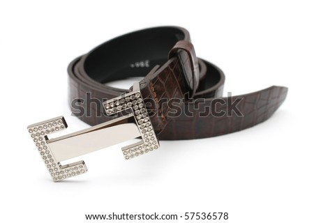 A rolled up lady belt isolated on white background. - stock photo