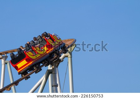 A roller coaster in a left curve - stock photo