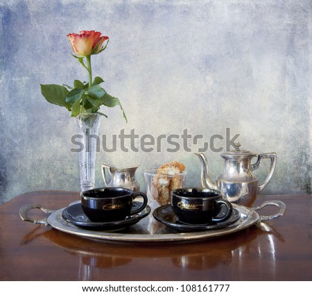 A romantic rose in a crystal vase and a cozy break for an espresso with almond cookies - stock photo