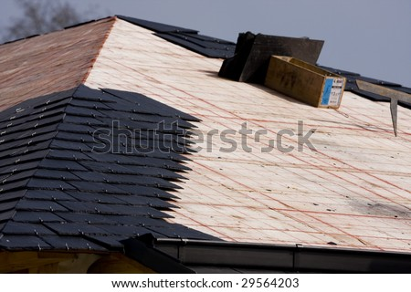 a roof in construction with slates - stock photo