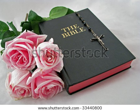 a rosary cross pink roses and bible - stock photo