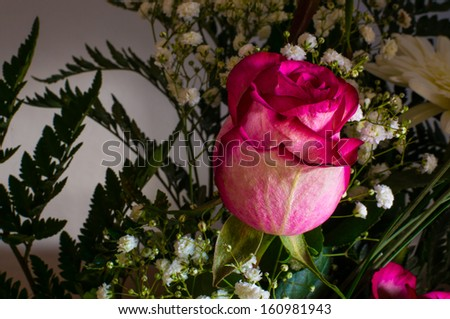 A rose in a bouquet - stock photo