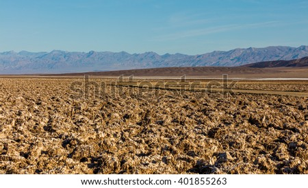 A rough texture from the large salt crystal formations. The floor of Death Valley is covered by a huge salt pan. Devil's Golf Course, Death Valley National Park - stock photo