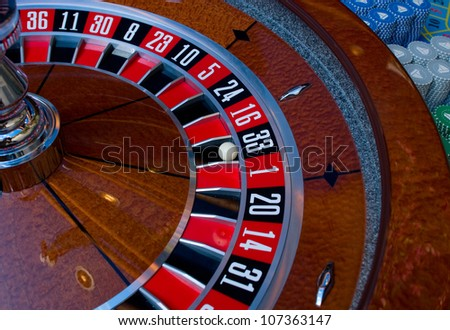 A roulette wheel at the casino. - stock photo