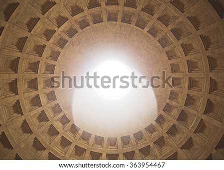 a round hole in the roof of the Roman Pantheon - stock photo