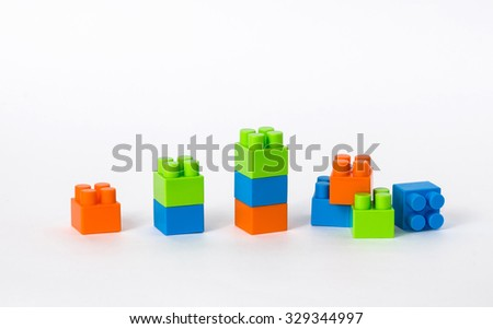 A row of blocks, forming a graph blue, green, orange. last low is broken - stock photo