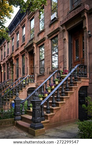 a row of brownstone apartments - stock photo