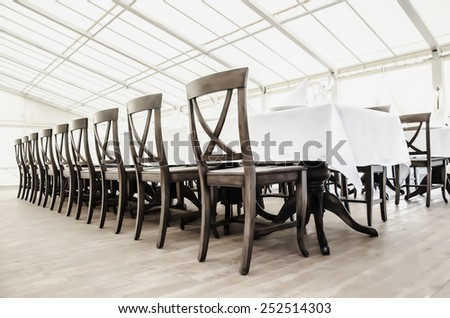 a row of chairs in the restaurant  - stock photo