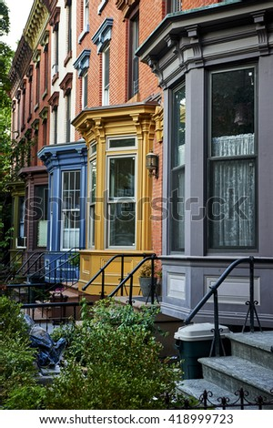 a row of colorful brownstone apartments - stock photo