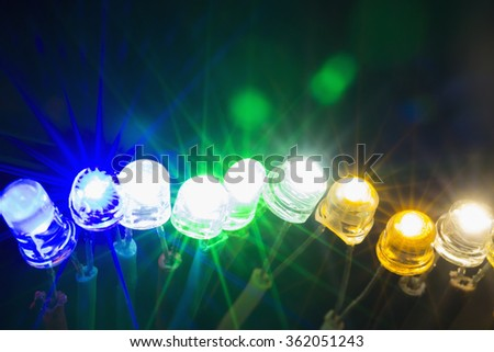 A row of colorful shining led lights - stock photo