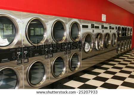 A row of dryers at a laundromat. - stock photo