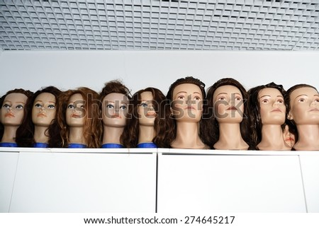 A row of dummies for the hairdresser - stock photo