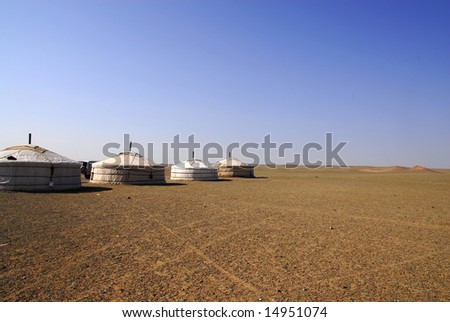 A row of gers in the Gobi Desert, Mongolia - stock photo