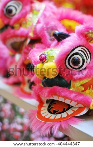 A row of Lion Dance Costume for sale - stock photo