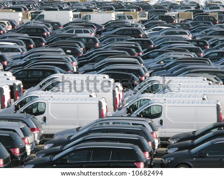 A row of new cars parked in port - stock photo