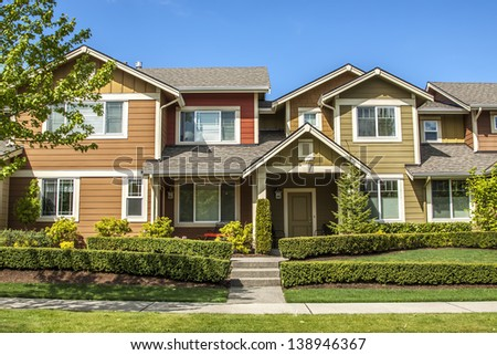 A row of new townhouses or condominiums  - stock photo
