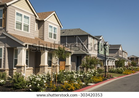 A row of newly-built houses in a residential subdivision. - stock photo
