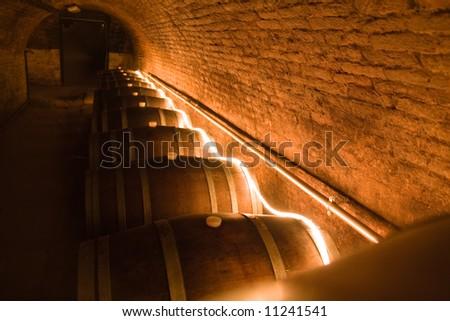 a row of old oak wine barrels - stock photo