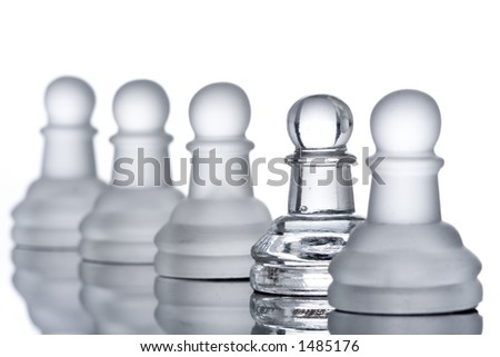A row of pawns with a clipping path - stock photo