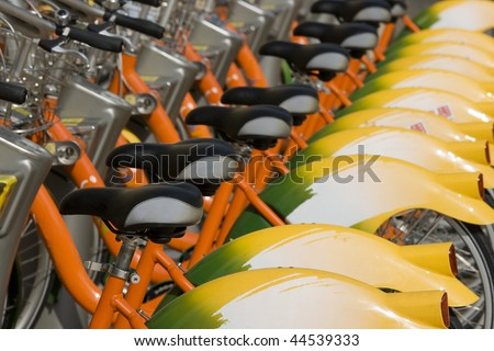 A row of public bicycles.  These bikes are part of the public transport system in Taipei, Taiwan. This helps to reduce traffic and keep the city greener. - stock photo