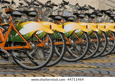 A row of public bicycles.  These bikes are part of the public transport system in Taipei, Taiwan. They help made Taipei Greener. - stock photo