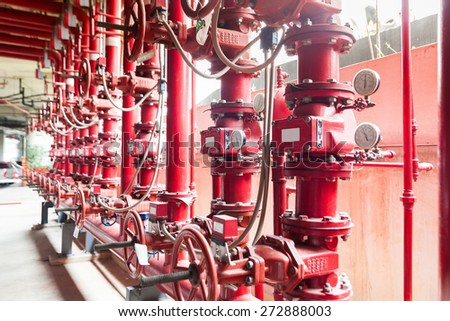 A row of red color fire fighting water supply pipeline system - stock photo