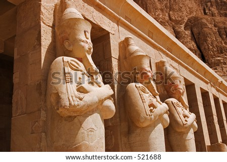 A row of staues of Queen Hatshepsut as Osiris, the god of the dead, at her temple in Luxor (Thebes) - stock photo
