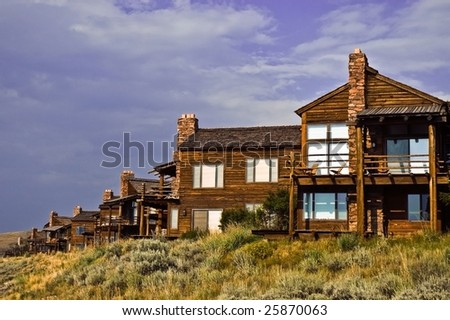 A row of vacation condominiums with a beautiful clouded sky in the background. - stock photo