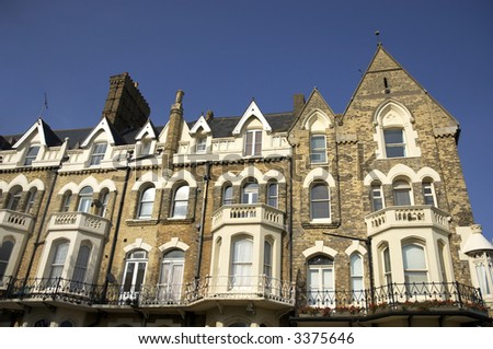 A row of victorian townhouses in England - stock photo