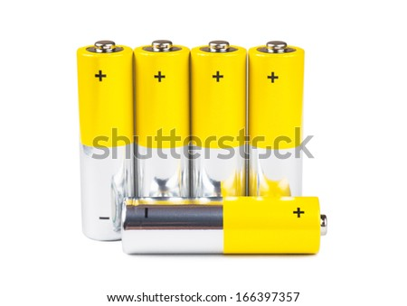 A row of yellow batteries isolated over white background - stock photo