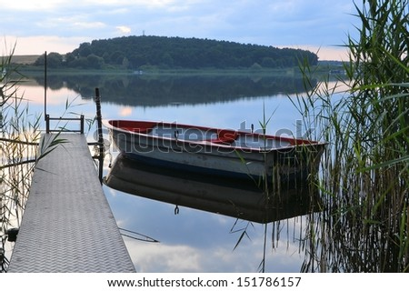 a rowing boat on a lake - stock photo